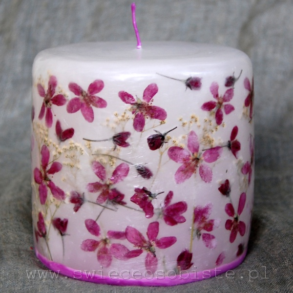 candle with flowers of purple crabapple, small