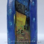 big candle with detail of Vincent van Gogh's painting Terrace of the café on the Place du Forum in Arles in the evening