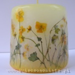 candle with flowers of the field, small