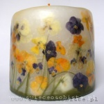 candle with colorful pansies