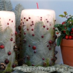 Christmas candle with fir, cones, holly berries and hawthorn, big
